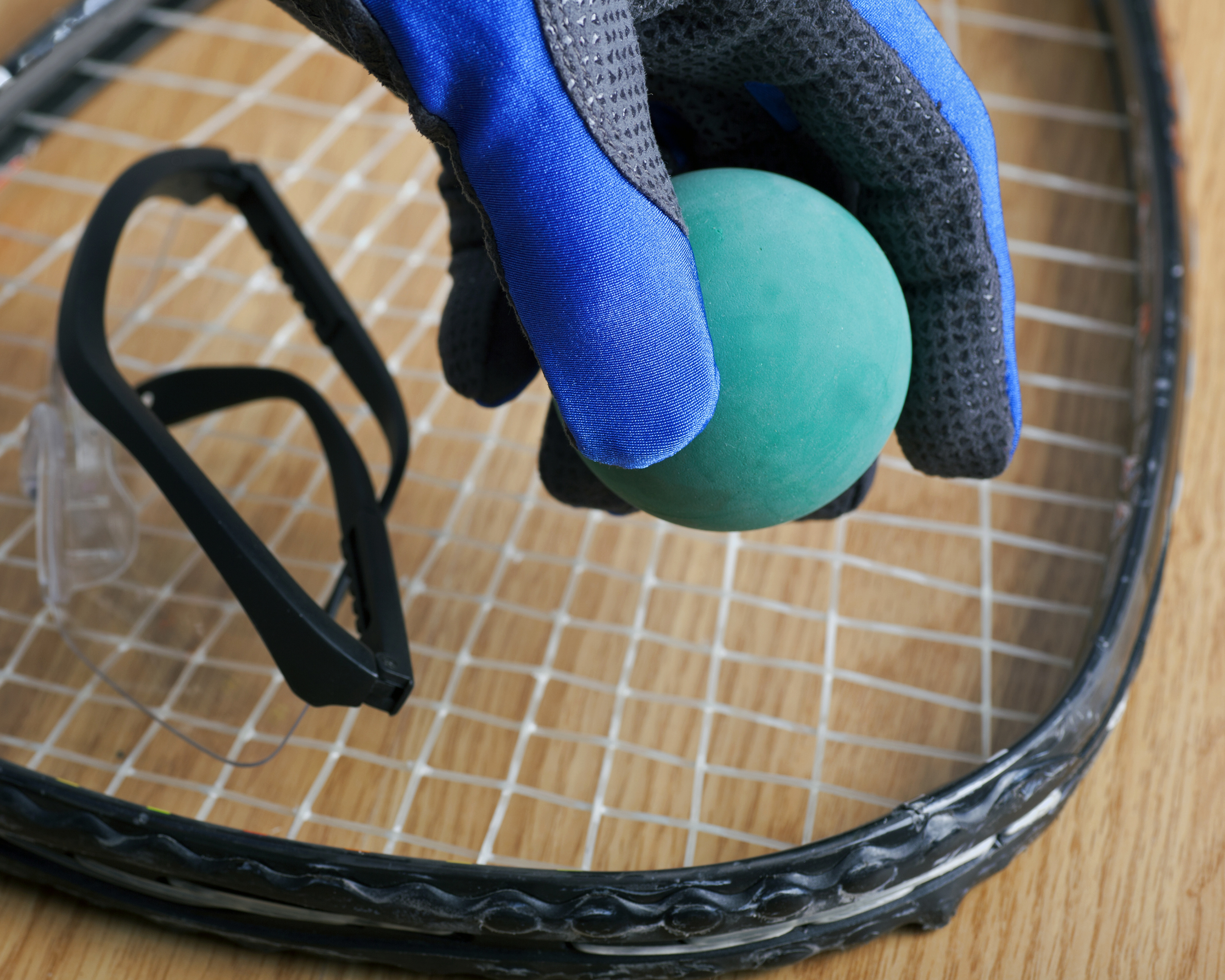 racquetball racquet with protective equipment
