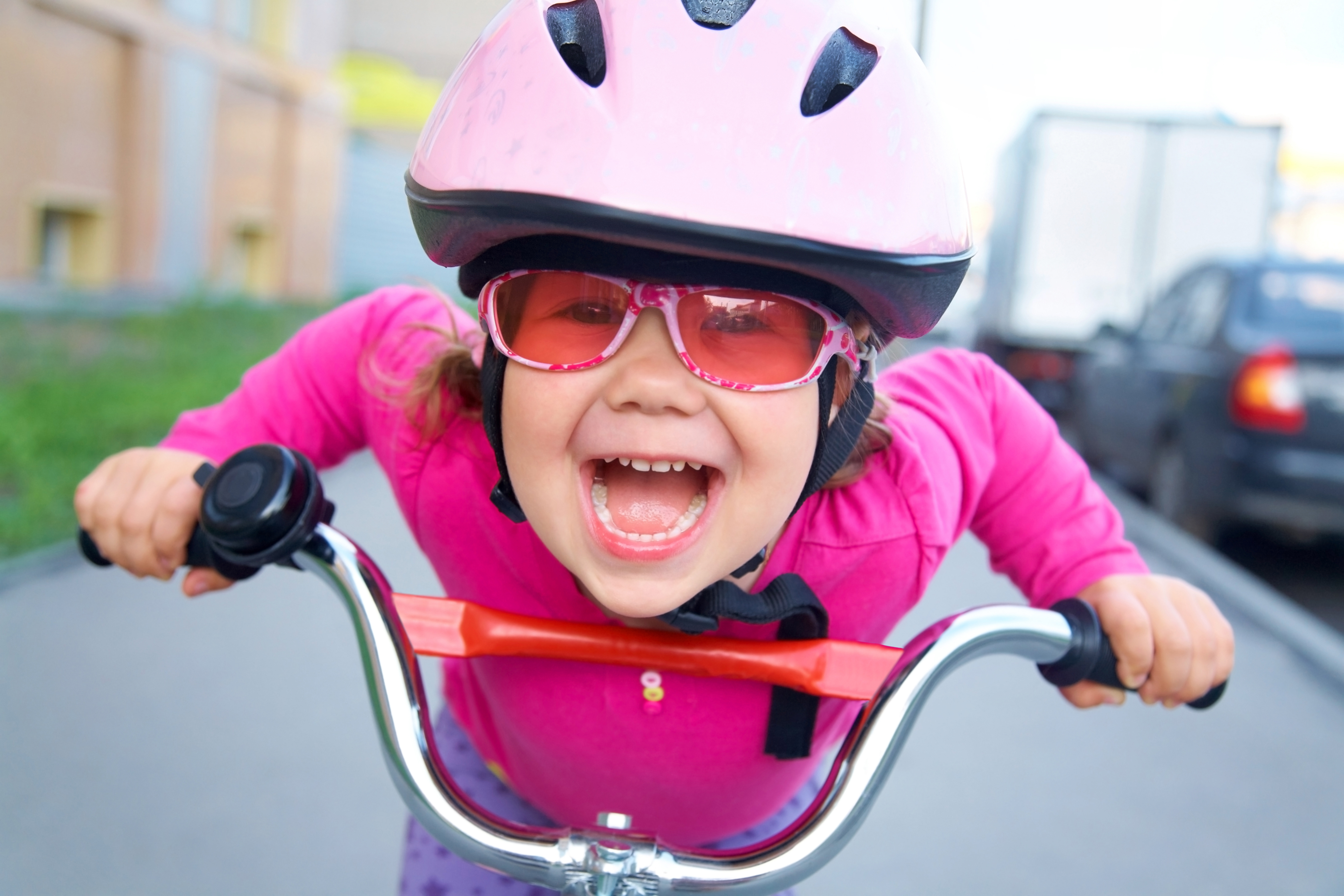 young girl wearing bike helmet