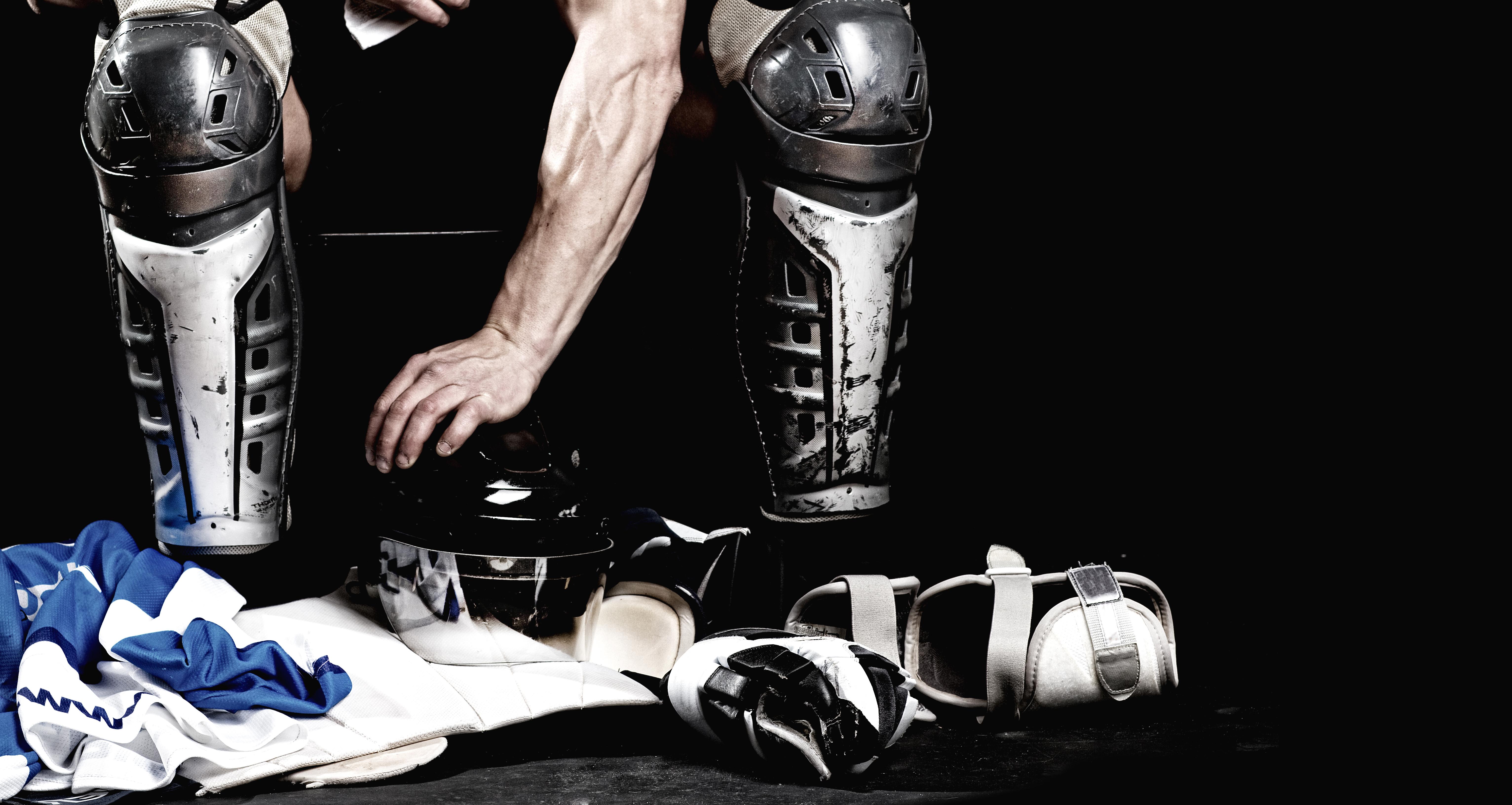 hockey player removing equipment