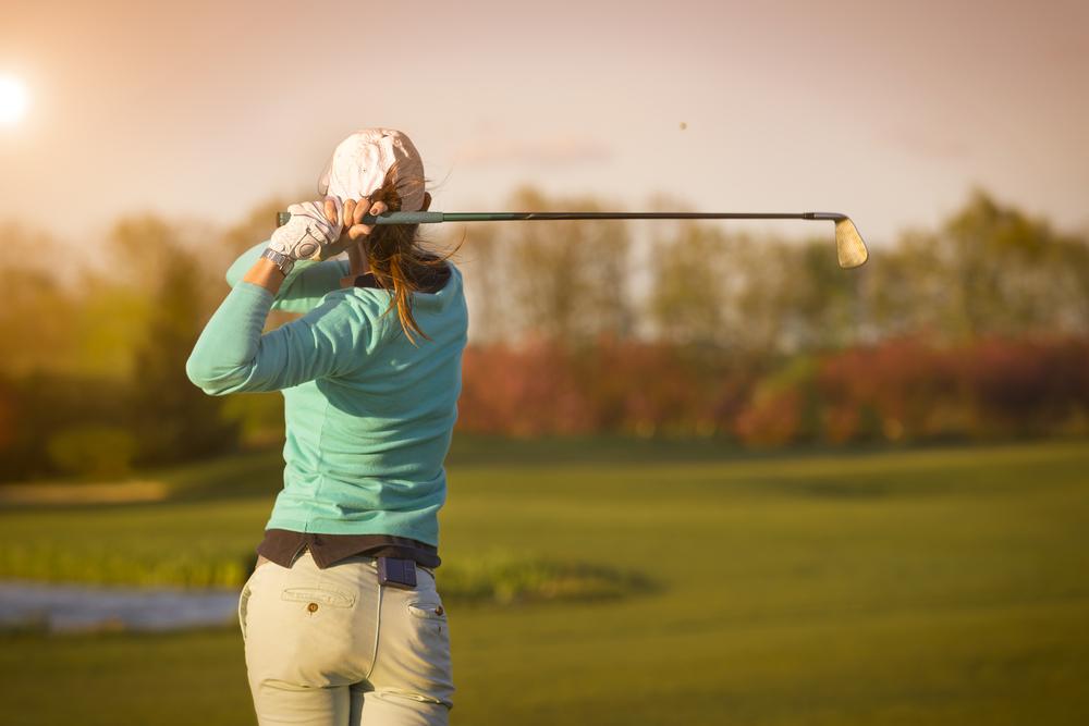 woman watching golf drive