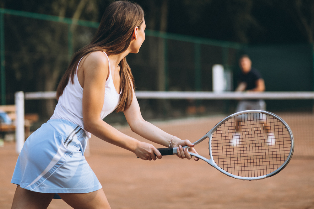 female tennis player ready to return a serve
