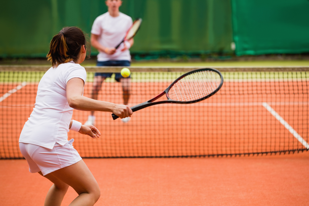 male and female tennis playing on court
