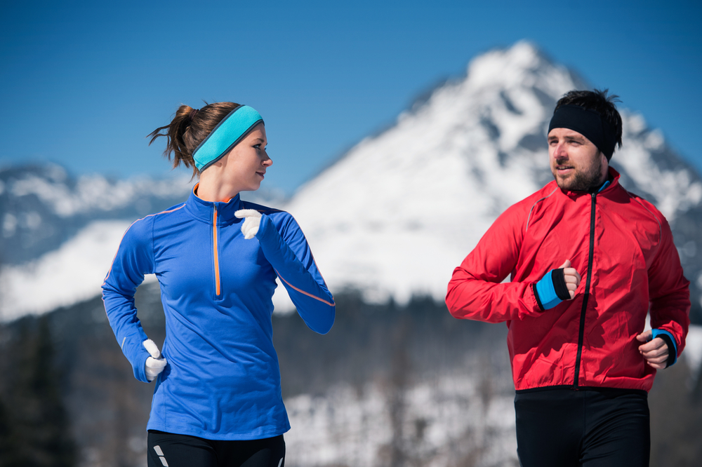 Male and female joggers wearing running headbands