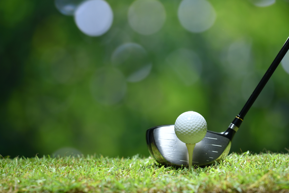 golfer about to tee off with driver