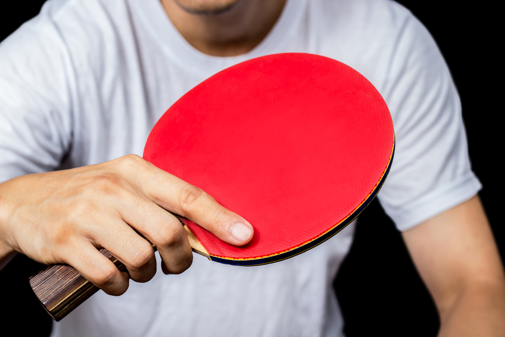 ping pong player using the shakehand grip