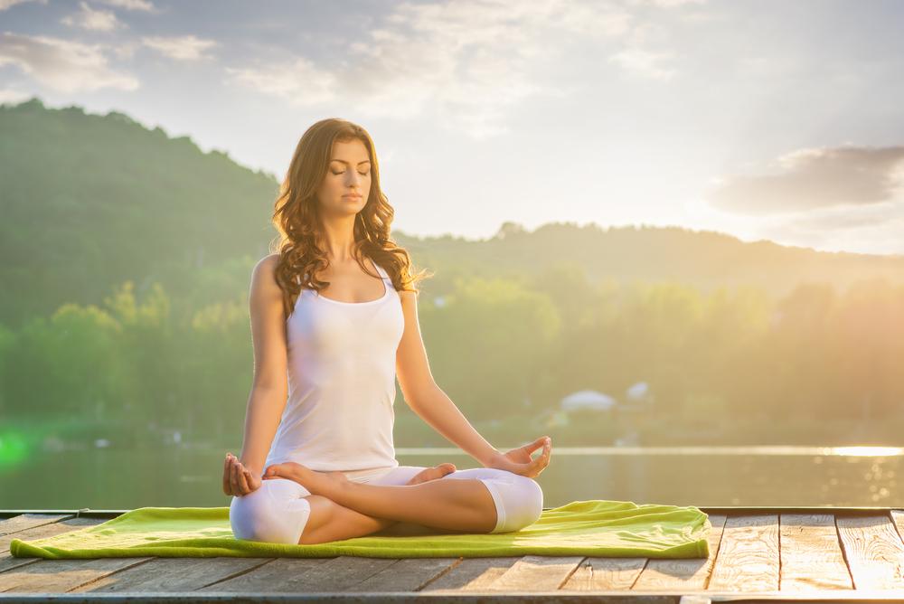woman doing yoga outside