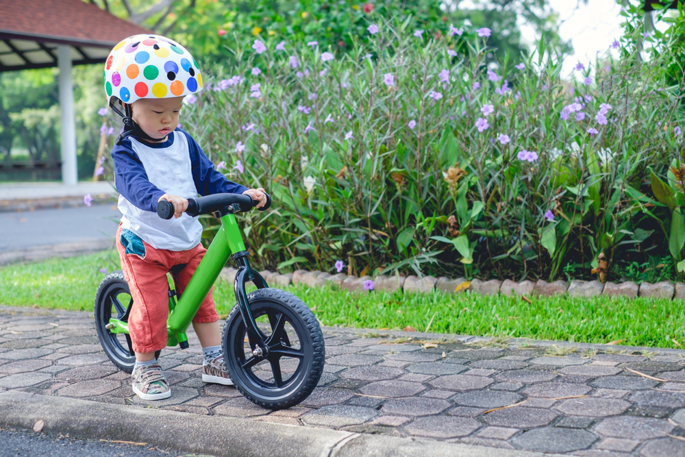 toddler figuring out how to ride bike