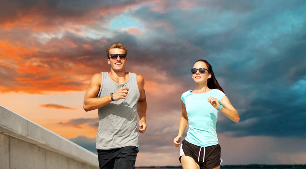 man and woman wearing running sunglasses