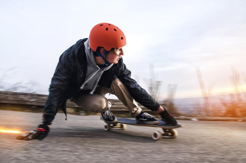 man does a slide on a skateboard