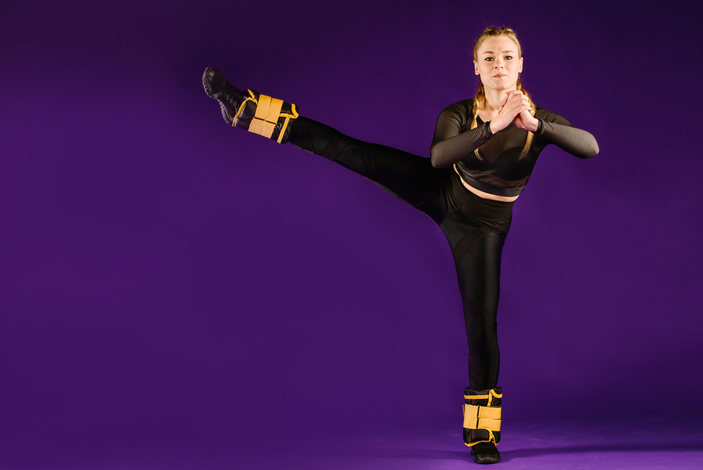 woman exercising with ankle weights on