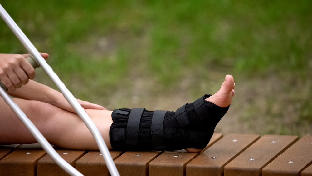 injured woman wearing ankle brace