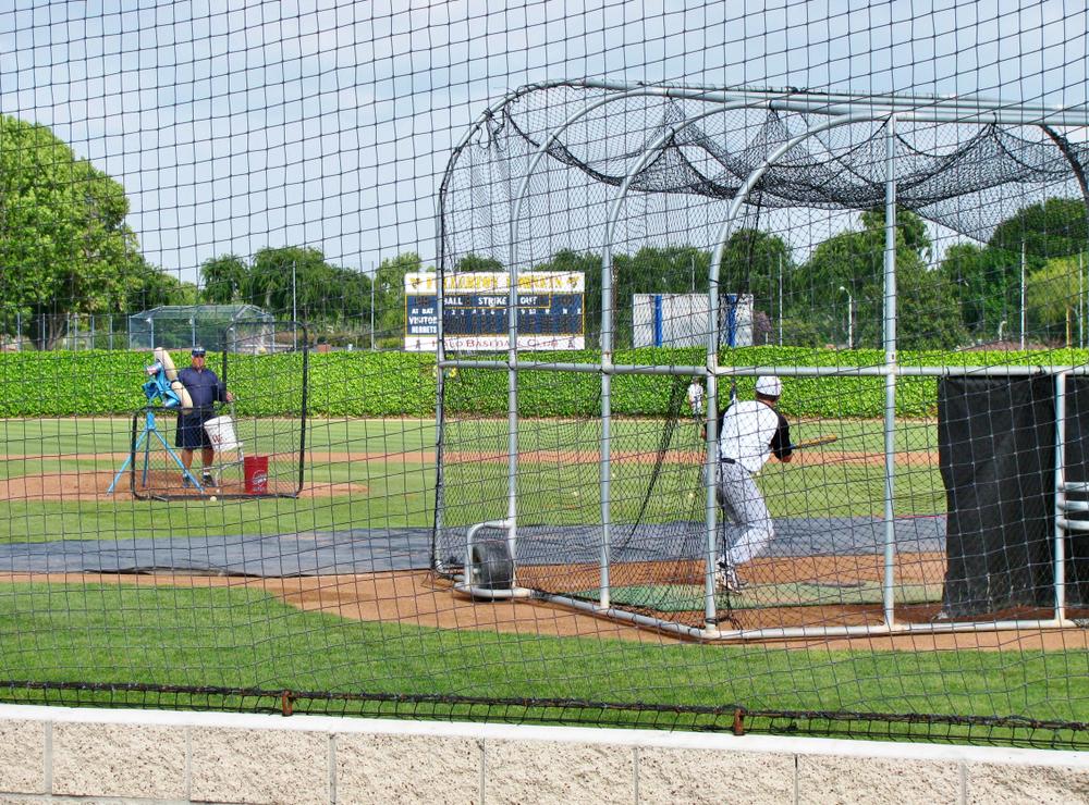 A baseball pitching machine and batting cage