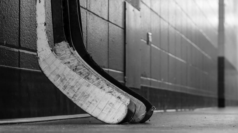 hockey sticks in a hallway