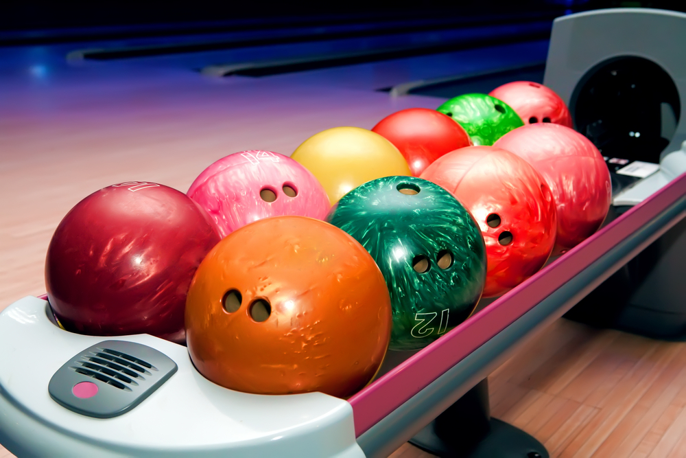 Bowling alley balls with large holes